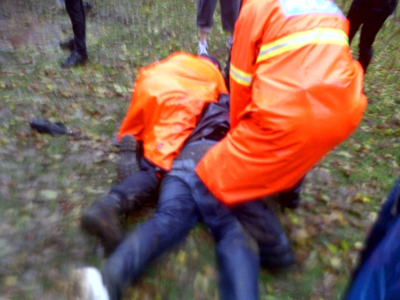 Occupy Nova Scotia Protester being arrested in the mud in Halifax at Victoria Park